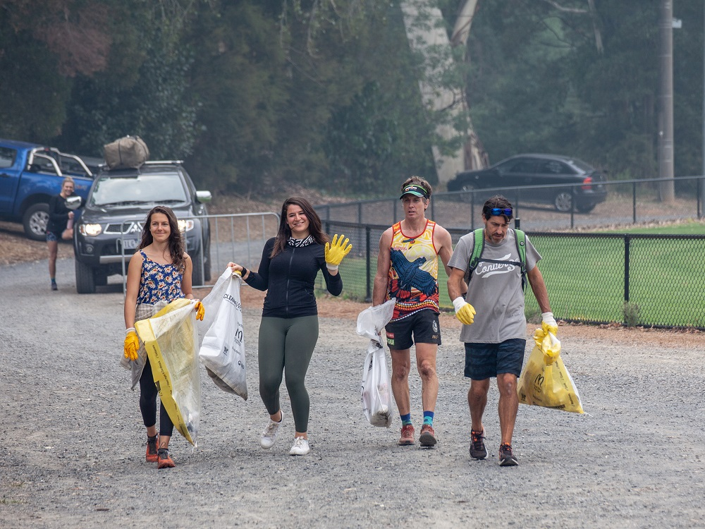 Picture showing 5 people in running gear with bags of rubbish they have collected