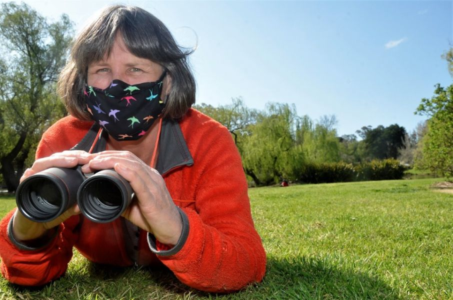 Lady with binoculars looking out for birds